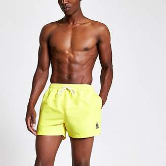River Island Neon yellow RI crest short swim shorts