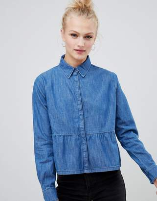 Asos Design DESIGN denim shirt with ruffle hem in midwash blue