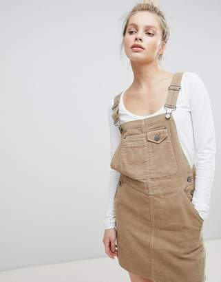 Asos DESIGN cord overall dress in stone