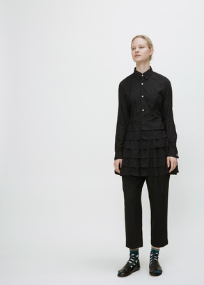 Comme des Garcons black tiered bottom long button-up shirt $636 thestylecure.com