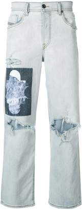 Diesel printed patch ripped jeans