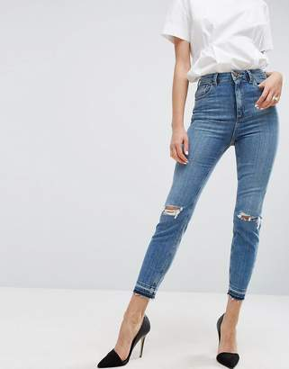 ASOS FARLEIGH High Waist Slim Mom Jeans In Hawthorn Mid Stonewash with Busted Knees and Let-Down Hems $53 thestylecure.com
