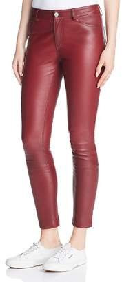 Theory Leather Skinny Jeans in Deep Mulberry