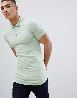 Asos DESIGN longline muscle fit polo with curved hem in green