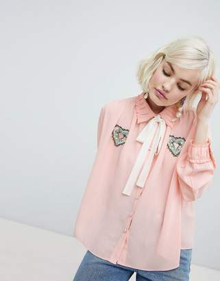 Sister Jane blouse with ribbon tie and heart patch detail