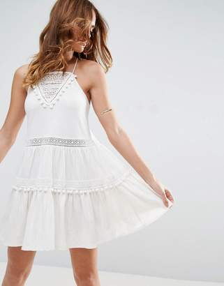 ASOS Sundress with Lace Inserts and Pom Poms $51 thestylecure.com