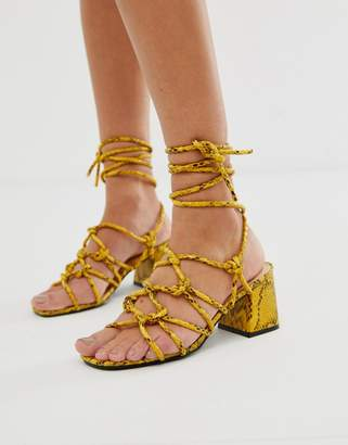 617593aaf43 Public Desire Freya bright yellow snake tie up sandals