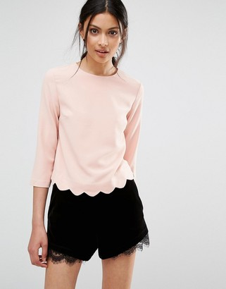 Oasis Top With Scallop Hem $43 thestylecure.com