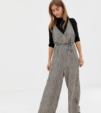 14a85e10afad Asos DESIGN Petite strappy wrap front jumpsuit in leopard animal print
