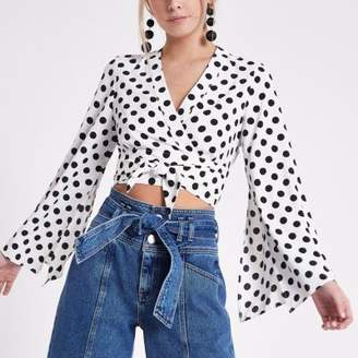 River Island Womens Petite white polka dot bell sleeve crop