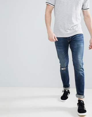 Benetton Slim Fit with Rips in Mid Wash
