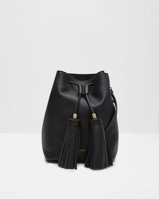 Tasseled leather bucket bag $269 thestylecure.com
