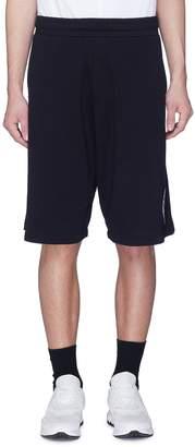 McQ Cube logo appliqué drop crotch sweat shorts