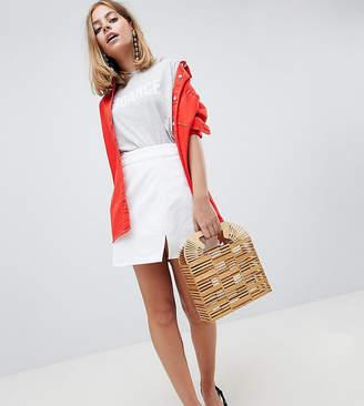 Asos DESIGN Petite Denim Mini Skirt In White With Split Detail