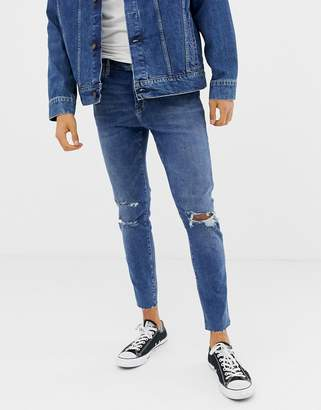 Bershka Join Life slim fit jeans in mid blue