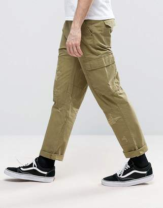 Asos DESIGN Slim Cargo Pants With Rip & Repair Detail In Khaki