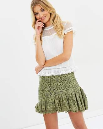 Atmos & Here ICONIC EXCLUSIVE - Amanda Mini Pleated Hem Lace Skirt