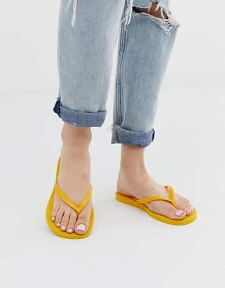 Havaianas slim thongs in bright yellow