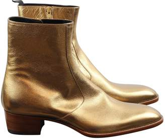 Saint Laurent Gold Leather Boots