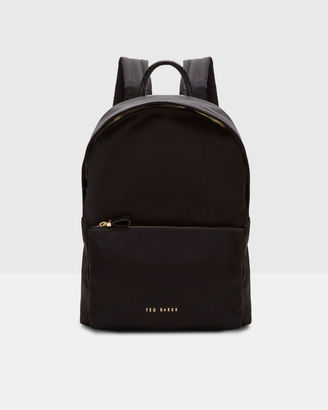 Textured trim backpack $159 thestylecure.com