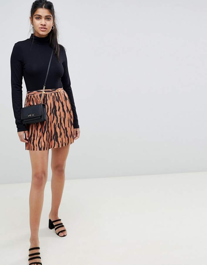 ASOS DESIGN pleated mini skirt in tiger print with gold buttons