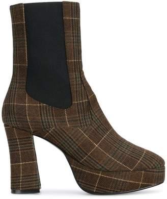 SAM. Nicole Saldaña plaid boots