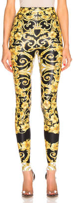 Versace Hibiscus Printed Leggings in Gold & Print | FWRD