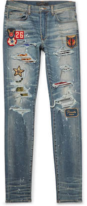 Amiri Skinny-Fit Appliquéd Panelled Distressed Stretch-Denim Jeans