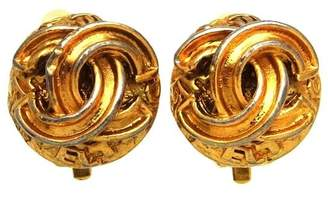 Chanel CC Logo Gold Tone Metal Round Earrings
