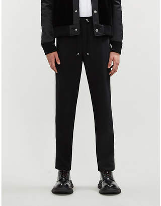 Balmain Satin-trim relaxed-fit tapered wool-blend trousers