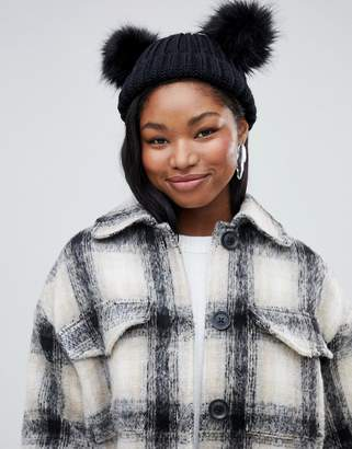 Miss Selfridge beanie hat with faux fur poms in black