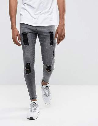 Illusive London Muscle Fit Jeans In Acid Wash Black With Distressing