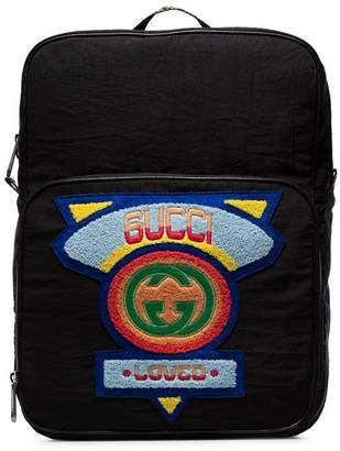 Gucci black logo badge embellished backpack