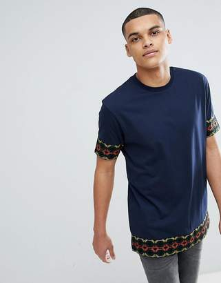 Asos DESIGN relaxed longline t-shirt with geo-tribal taping in navy