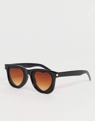7x SVNX sunglasses with heart shaped lens