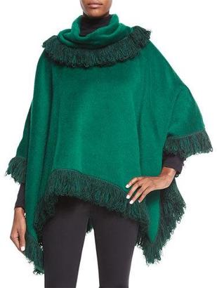 Dolce & Gabbana Cashmere Textured Fringe Poncho $3,295 thestylecure.com