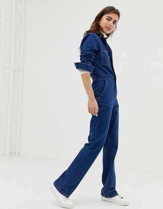 Asos Design DESIGN flare boilersuit with patch pockets in midwash blue