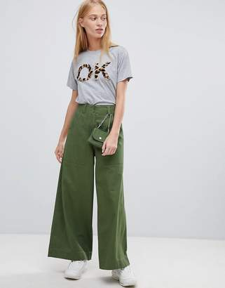 Asos DESIGN wide leg pants with detachable bag in khaki