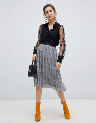 B.young check pleated skirt