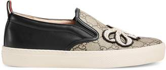GG Supreme slip-on with pearl bow $950 thestylecure.com
