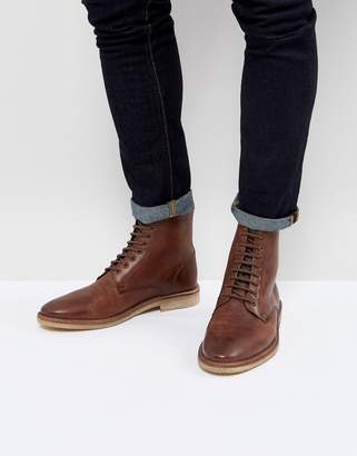 Asos DESIGN lace up boots in tan leather with natural sole