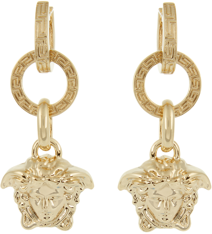 Original Oversized Ornamental Earrings Adorned Models Ears  The Mood Is Happiness It Is Modern, It Is Alive, It Is A Gift To The Women, Stated Versace Of The Event,