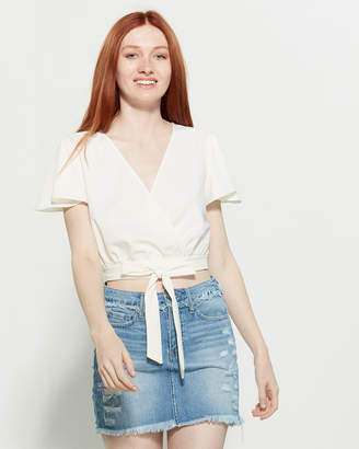 Necessary Objects Faux Wrap Cropped Blouse