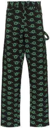 Ashley Williams rose print trousers