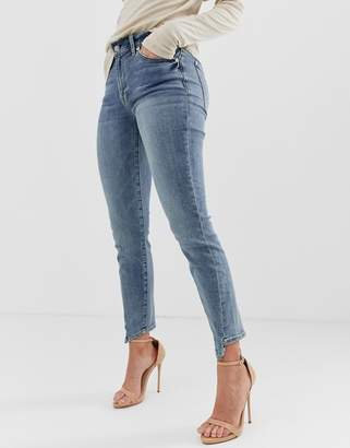 7 For All Mankind ankle grazer skinny jeans with spliced hem