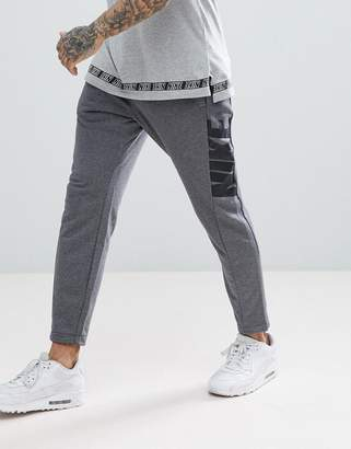 Nike Hybrid Joggers In Tapered Fit In Grey 885947-071