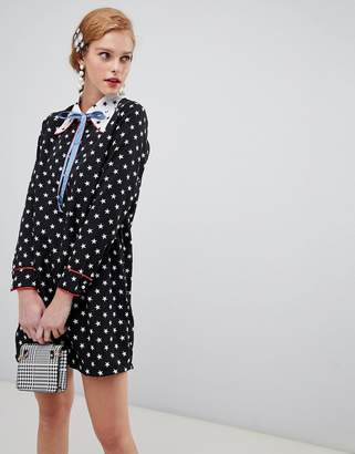 Sister Jane shift dress with ribbon tie in contrast star print