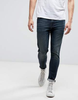 Asos DESIGN Skinny Ankle Grazer Jeans With Dirty Blue Wash