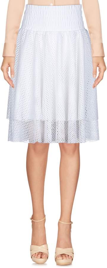 PUMA Knee length skirts