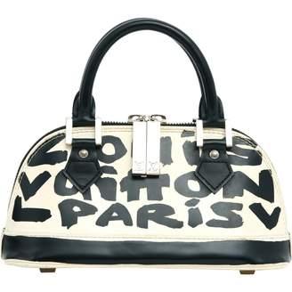 Louis Vuitton Alma BB leather handbag